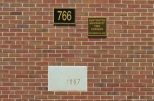 A plaque accompanies the time capsule hidden in the cornerstone in the front wall of the HUB. (Photo by Christian Herrera)