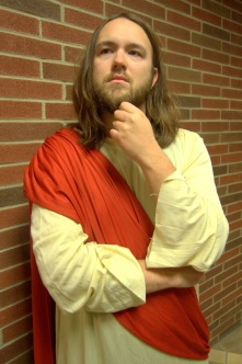 Andrew Franks poses in his robe and sash as Jesus Christ. (Photo by Christian Herrera)